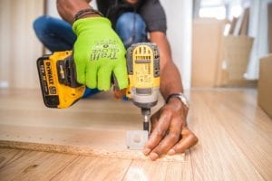 picture of construction worker using a drill